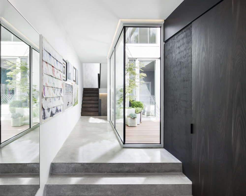 Every room in the house looks onto an outdoor space. Click here to see more modern homes that use courtyards as a design element.  Concrete Obsessed by Amy Phare from A Minimal, Metal-Clad Montreal House With A Hidden Courtyard