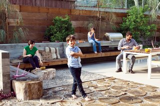 "A Fresh Dose of Color Livens Up This Midcentury Los Angeles Home - Photo 5 of 13 - The first thing landscape designer Laura Cooper asked Devis and Purdy was to recall childhood gardens and outdoor play. In that spirit, she designed their backyard, integrating the high ground with the low just outside the ""kids' wing."" The resulting series of outdoor rooms on this quarter-acre is full of memory and play."