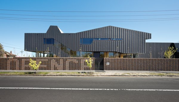 The exterior of the Housemuseum has something of a Darth Vader look to it, without directly mimicking the brutalism that exemplified much of Melbourne's modernist architecture of the 1960s. The street names that form the corner on which it sits—Cotham and Florence—are marked out in the chocolate-brown brickwork fence.