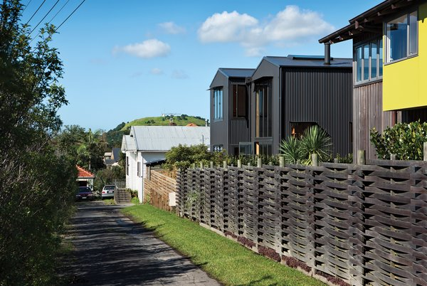 With its pitched roof and verticality, the house blends with the surrounding seaside neighborhood yet remains architecturally distinct thanks to its aluminum cladding.