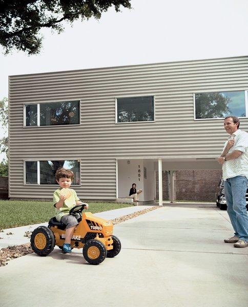 Leroy tools around on his mini turbo tractor while munching on a gigantic cookie; his parents look on with envy.