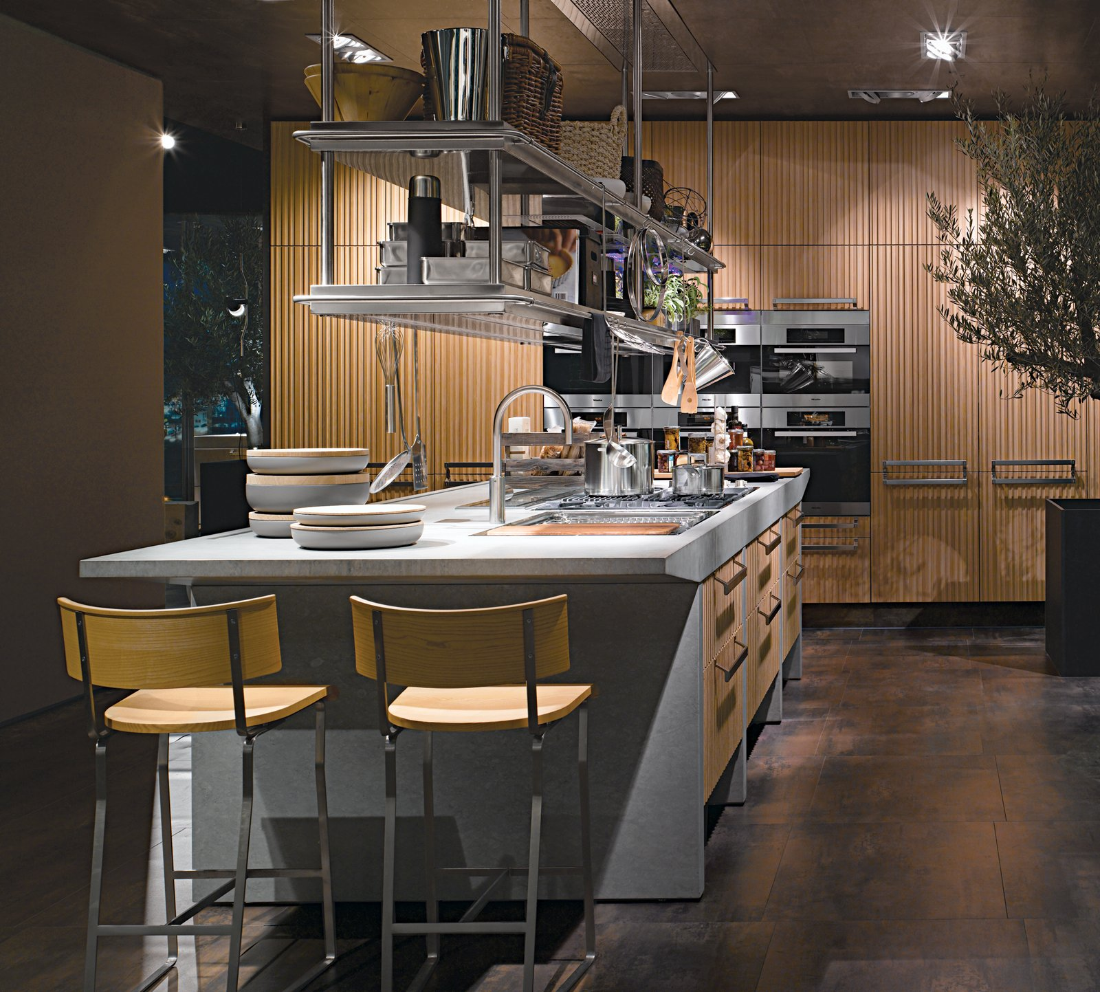 Arclinea's Lignum and Lapis kitchen system features green materials, professional-grade appliances, and advanced technology like a miniature greenhouse for growing herbs indoors and a retractable glass hood over the cooktop. An Introduction to Kitchen Design - Photo 5 of 7