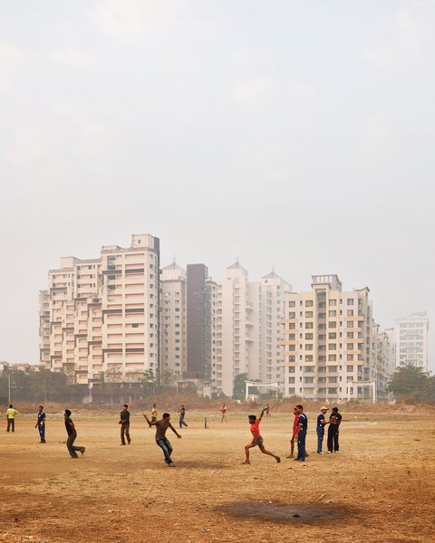 An impromptu cricket game occupies locals in Navi Mumbai.