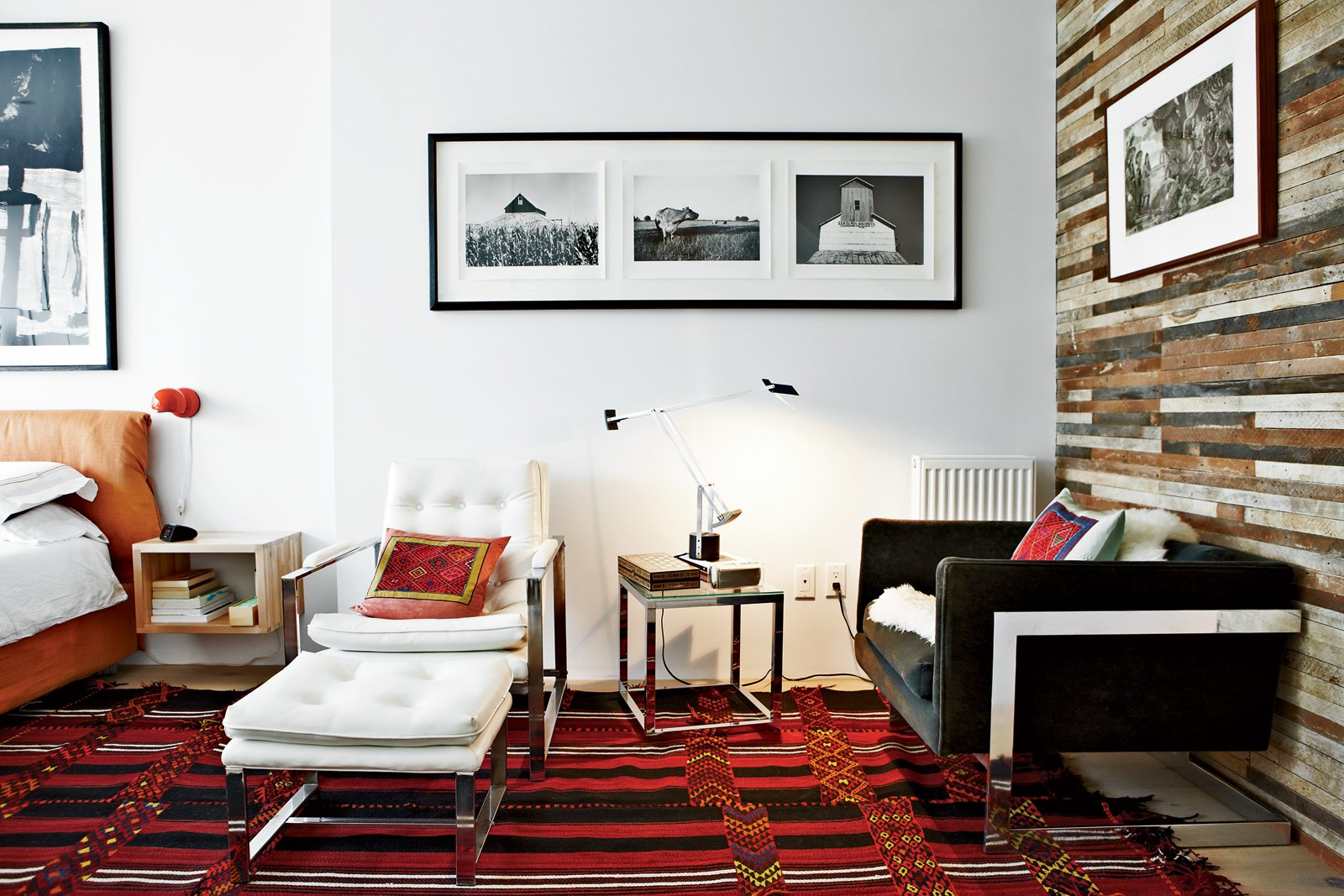 In the master bedroom, the couple opted for Artemide lighting: Vintage Eclisse table lamps by Vico Magistretti hang over the nightstands and a Tizio table lamp by Richard Sapper rests on a side table. The lounge chairs are vintage finds, and the rug is a Bedouin design purchased in Jerusalem. Don't Let the Sign Fool You, This Old Storefront is a Home - Photo 8 of 11