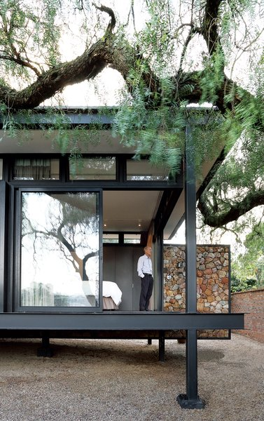 Architect Georg van Gass adds a delicately poised cantilevered exterior wall that appears to slice the deck in half. Photo by: Elsa Young