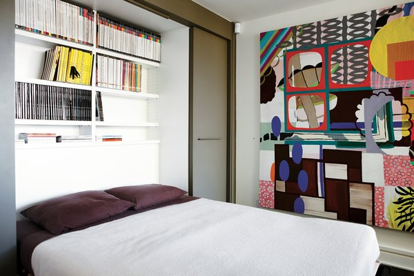 Montague's office doubles as a guest room thanks to a Murphy bed that folds out to reveal shelves stocked with design magazines. The painting is Untitled (Corner Rainbow) by Elizabeth McIntosh.