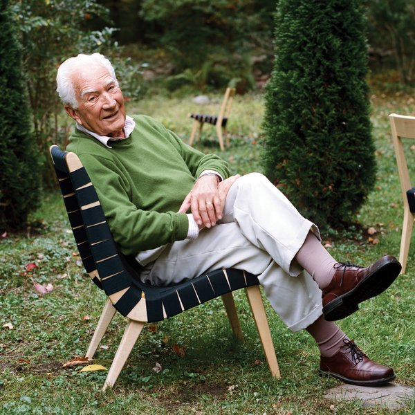The designer in his iconic Risom lounge chair.