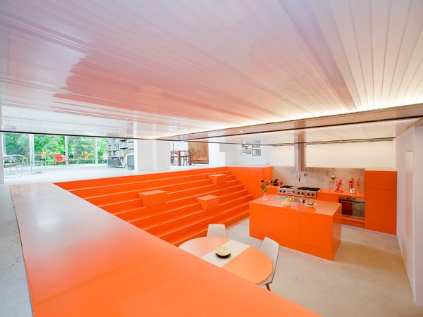 A bright-orange polyurethane coating rescues the dugout from any suggestion of darkness or dinginess. Photo  of Parksite Residence, Rotterdam modern home