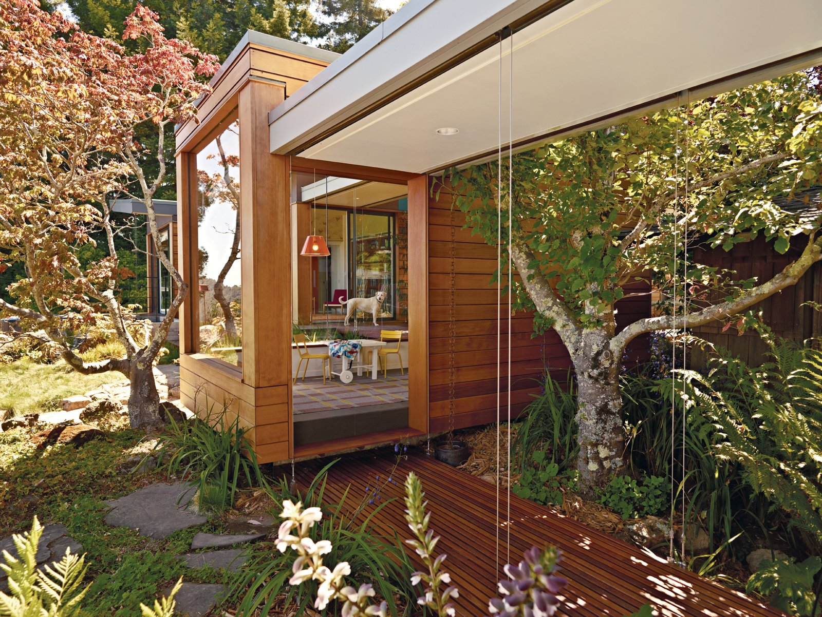 "The tearoom, reached by breezeways on either side, provides a transition from the main house to the pavilion, which measures 1,800 square feet. ""The pavilion has a distinctive Japanese flair to it, like the original house,"" says Parco.  Midcentury Homes by Dwell from A Modern Prefab Addition to a Mid-Century California Classic"