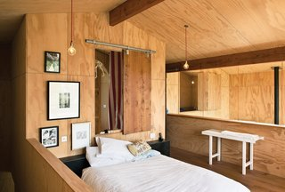 10 Cozy Spaces and 15 Products to Help You Get Ready For Fall - Photo 1 of 10 - Plywood-covered walls and French oak floorboards make this attic-level bedroom in New Zealand feel warm and cozy. Low walls and high ceilings, along with great lighting, keep the space golden and bright, instead of dark and gloomy.