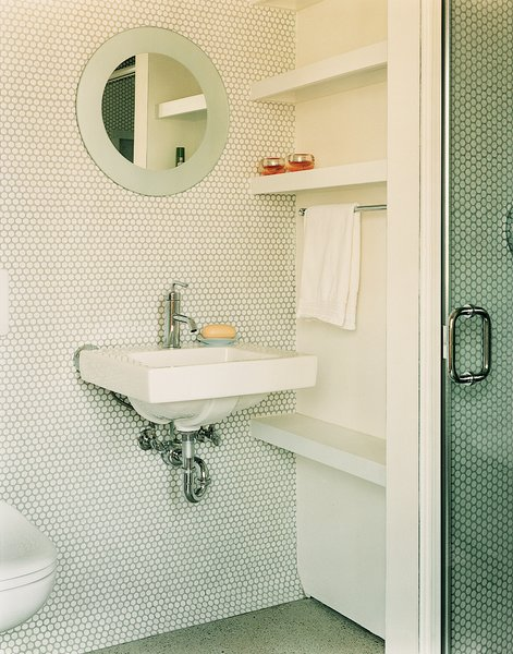 "In the guest bathroom, penny tiles were chosen ""because they're incredibly economical, utilitarian, and we liked their kitschy feel,"" explains Gaffney."