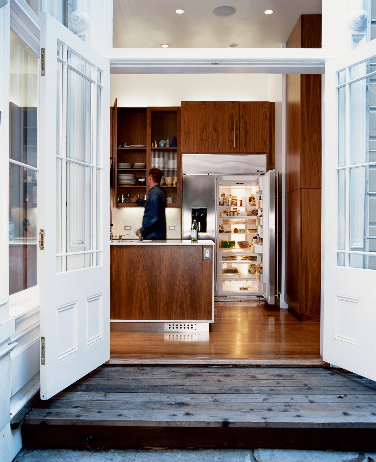 The walnut cabinets in the kitchen, which update and warm the space, were designed by Nilus de Matran and fabricated by George Slack. Taking Liberties - Photo 1 of 8