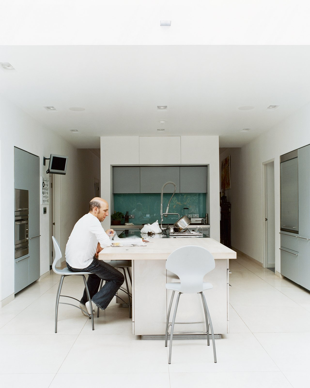 "To avoid formality, Phillips created a different environment for each room. The kitchen, for example, is understated by virtue of its simple cabinetry by Boffi, and its white walls that flow with the rest of the house. ""What we love about living here,"" says Judith, ""is that it works well with our young family. There is plenty of daylight, all the latest technology, and we don't have to worry about sticky fingers destroying anything.""  Photo 6 of 10 in Victorian Secrets"