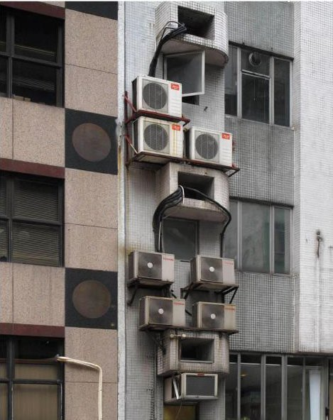 An exterior detail shows a jumble of air-conditioning units. Photo by Michael Wolf, courtesy of the Flowers Gallery.