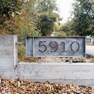Small Amidst Sprawl - Photo 4 of 5 - Schatz and Eamon bought a small sheet of copper, cut out their house numbers, mixed and poured some concrete, and voilá-- their own groovy house numbers for $125.
