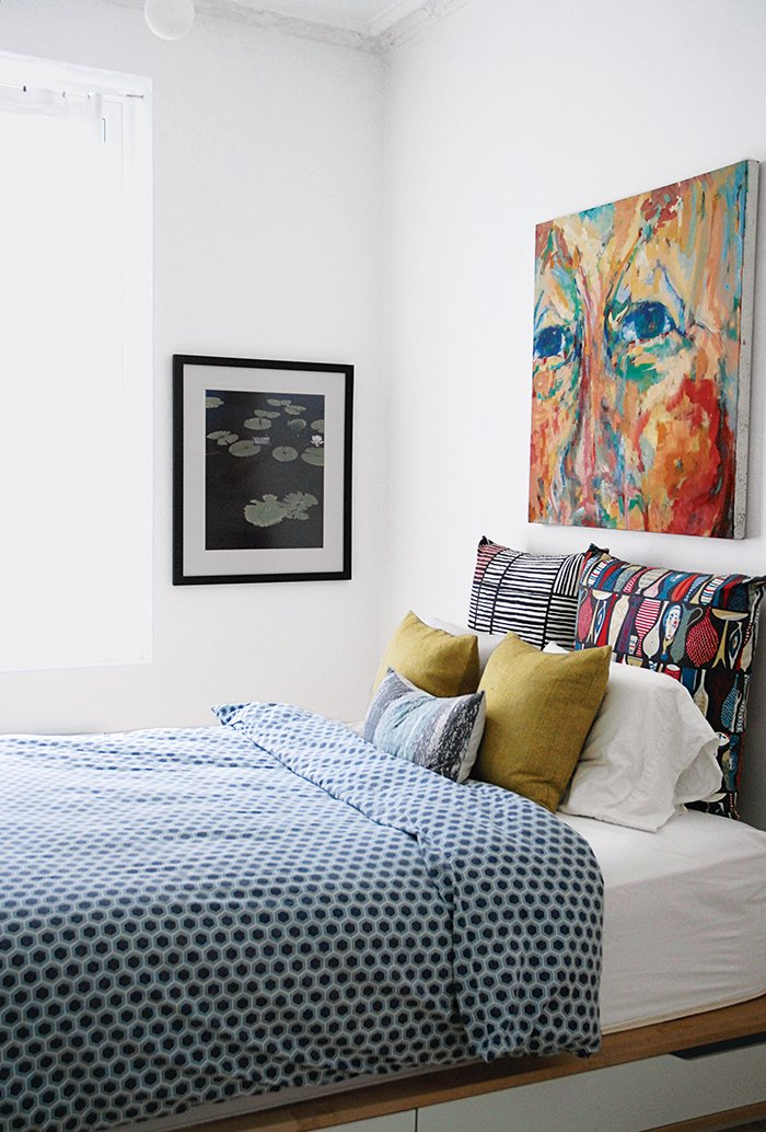 Additional storage was added under the master bed to replace the closets lost in the renovation. Bedrooms by Dwell