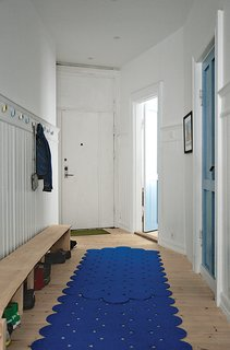 Budget-Friendly Renovation of a Neoclassical Home in Oslo - Photo 9 of 11 - Inspired by brightly colored doors in Notting Hill, London, Casper and Lexie chose a few distinct hues for interior doors in their renovated apartment, such as blue Flügger paint for the laundry room door.