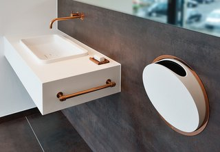 10 Ideas For the Minimalist Bathroom of Your Dreams - Photo 9 of 10 - Arne Jacobsen designed these fixtures for Vola in 1968. In 2014, the Danish company added a deep copper finish to the line. Shown here is the 112 faucet and mixer series and the round series in-wall accessories.
