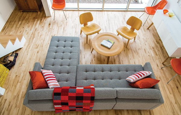 """A Versatile House Fulfills All This Musician's Needs - Photo 3 of 11 - A Dual Pebble tufted sectional sofa by Gus Design Group for CB2 is the focal point of the living space. The maple floors are composed of inexpensive """"shorts"""" left over from other projects and sold at a discount."""