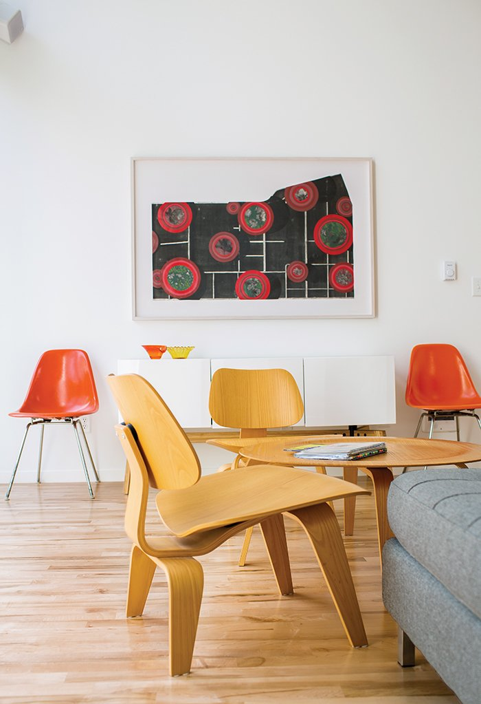 Magill furnished the living area with an Eames coffee table and molded plywood chairs that she bought from a neighbor. The Eames fiberglass chairs were eBay purchases, and the Alba credenza is from CB2. The lithograph is by St. Louis artist Sage Dawson.