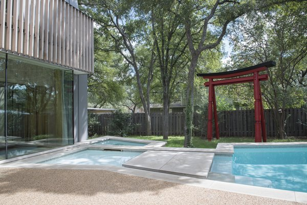 """The pool's pinched center and a nearby shade tree reflect the Japanese concept of """"wabi-sabi,"""" or imperfection in beauty. A large stepping stone also references a stepping stone in a Japanese garden pool."""