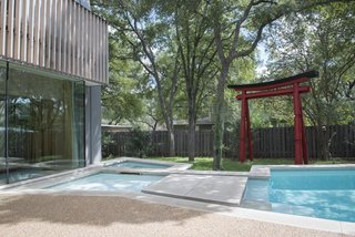 """8 Japanese-Inspired Spaces We Love - Photo 6 of 8 - During Webber + Studio's renovation and expansion of a midcentury home, the architects sought to imbue a sense of """"wabi-sabi,"""" or imperfection in beauty, with an irregularly shaped pool and dappled light that's provided by a nearby tree. Large stepping stones and a garden gate also reference Japanese elements."""