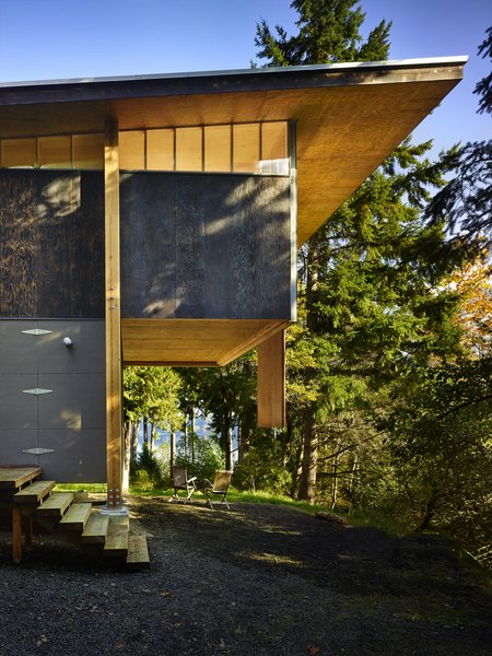 """The cantilevered sleeping loft posed a structural challenge. """"The structure is simple, however we explored a number of options for supporting the cantilevered loft,"""" Eerkes says. """"But after comparing costs for large trusses versus a big glulam beam—including labor costs for construction of each—the simplicity of a two-foot glulam beam won out. The steel rod cross bracing provided lateral stability in the longitudinal direction."""""""