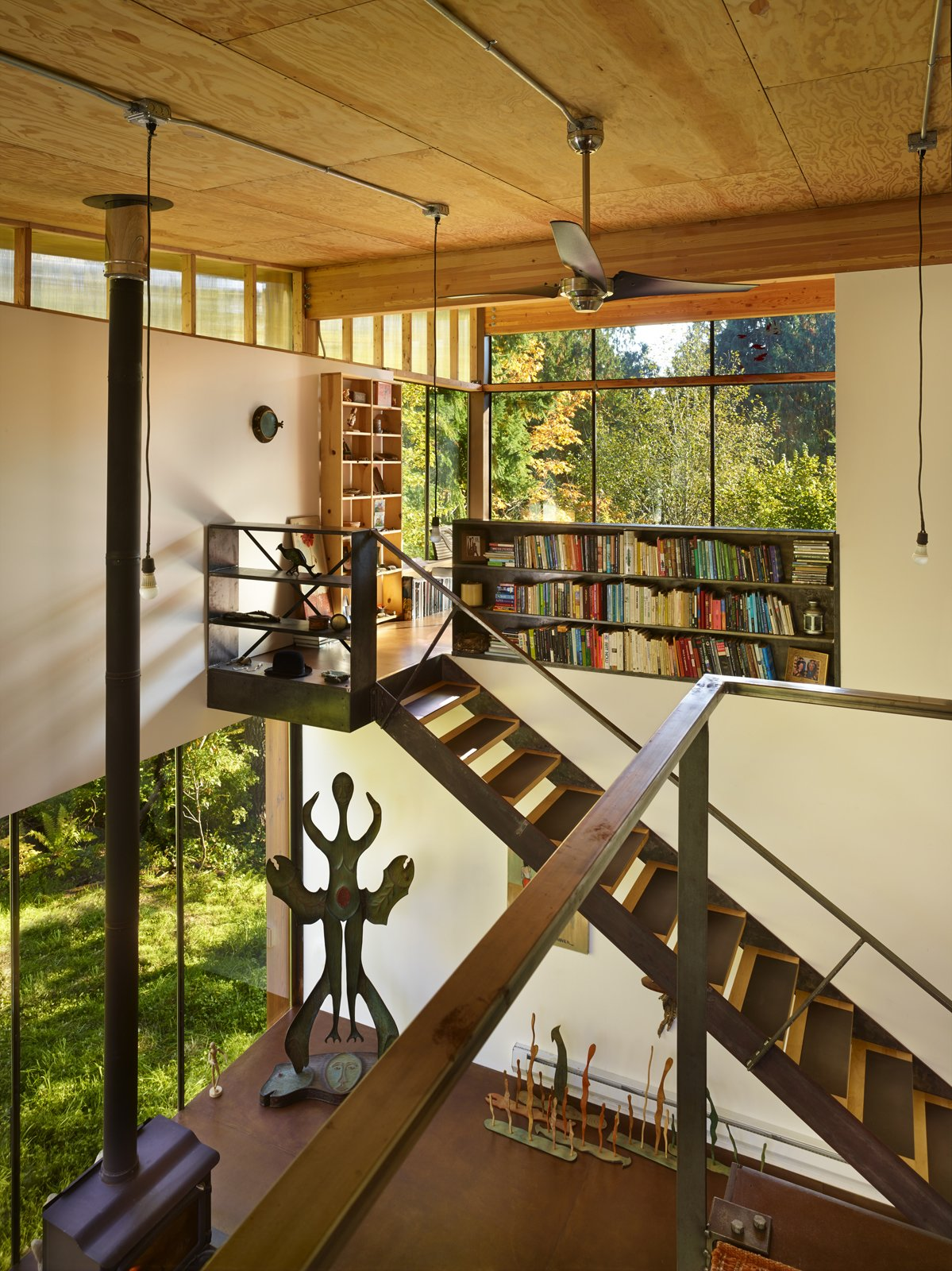 Cost-effective hot-rolled steel—steel being an Olson Kunding signature—covers the treads on the staircase leading to the sleeping loft. Tagged: Living Room.  Dream by Tabitha Rae from An Eco-Friendly Compact Cabin in Washington