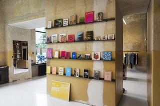 A Design Boutique Opens in Poland - Photo 1 of 7 - Books are displayed on one wall in a room of the Geszeft boutique that houses a cafe. Photo by Anna Domańska.
