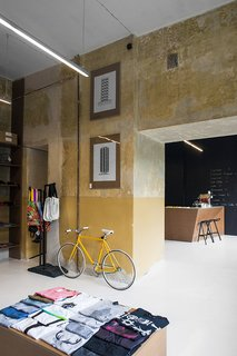 A Design Boutique Opens in Poland - Photo 3 of 7 - The ochre concrete walls have a deliberately rough quality to them. Photo by Anna Domańska.