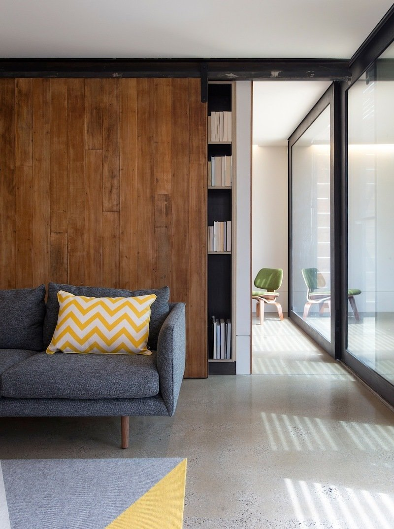 The living room features an operable door which leads to the patio. Photo by Andrew Wuttke.