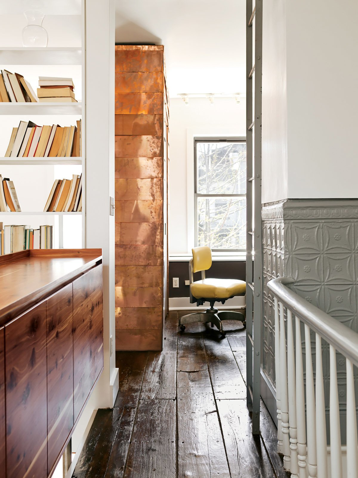 The copper-covered volume extends from the first floor, where it contains coat and shoe storage. Tagged: Office, Chair, and Shelves.  Fall Design Trend: Gold, Brass, and Copper Accents by Megan Hamaker from New Prospects