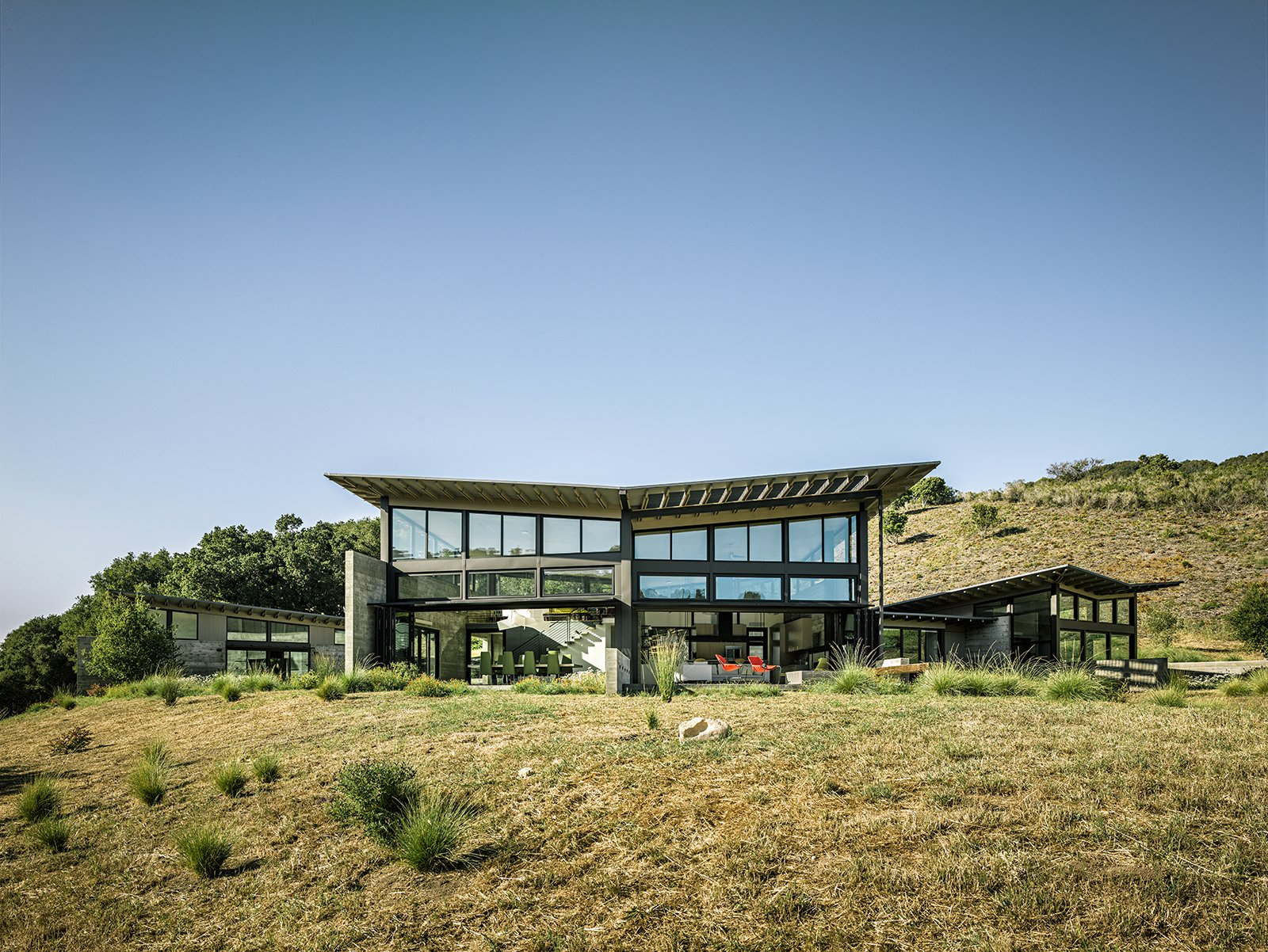 """""""Pulling the buildings apart allows what is not a big house to feel really big,"""" says architect Jonathan Feldman of the sustainable retirement home he built for a couple in California. """"Because of the ways it opens up, it feels much more expansive than it really is."""" Tagged: Exterior, Concrete Siding Material, House, Metal Siding Material, Metal Roof Material, and Butterfly RoofLine.  Photo 4 of 6 in Focus on Feldman Architecture's Environmentally-Conscious Homes from Sustainable Retirement Home in Tune with California Landscape"""