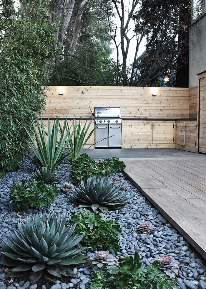 Another water-saving project in Menlo Park includes a rock bed with succulents.