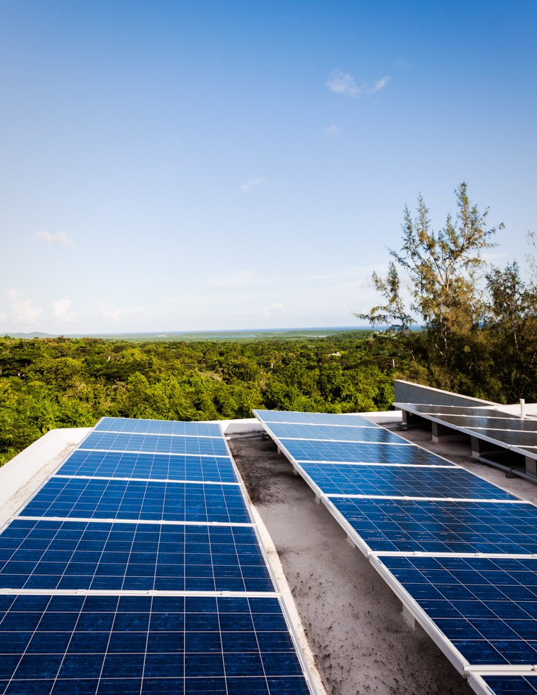 "On the roof, Casa Solaris has 24 solar panels, which feed to 12 batteries in what the architect calls ""the engine room,"" plus two 50-gallon, solar hot water heaters, which feed to the sinks and outdoor showers. Photo by Michael Grimm.  Photo 9 of 9 in Modern Concrete Getaway in Paradise"