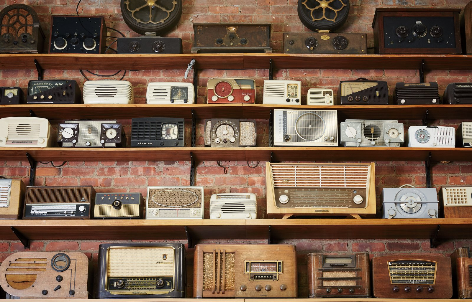A wall of vintage radios and receivers lends a layer of kitsch to Tekserve's Manhattan retail space.  Photo 1 of 7 in Meet the Tech Shop That's Been Fixing Macs Longer Than the Apple Store