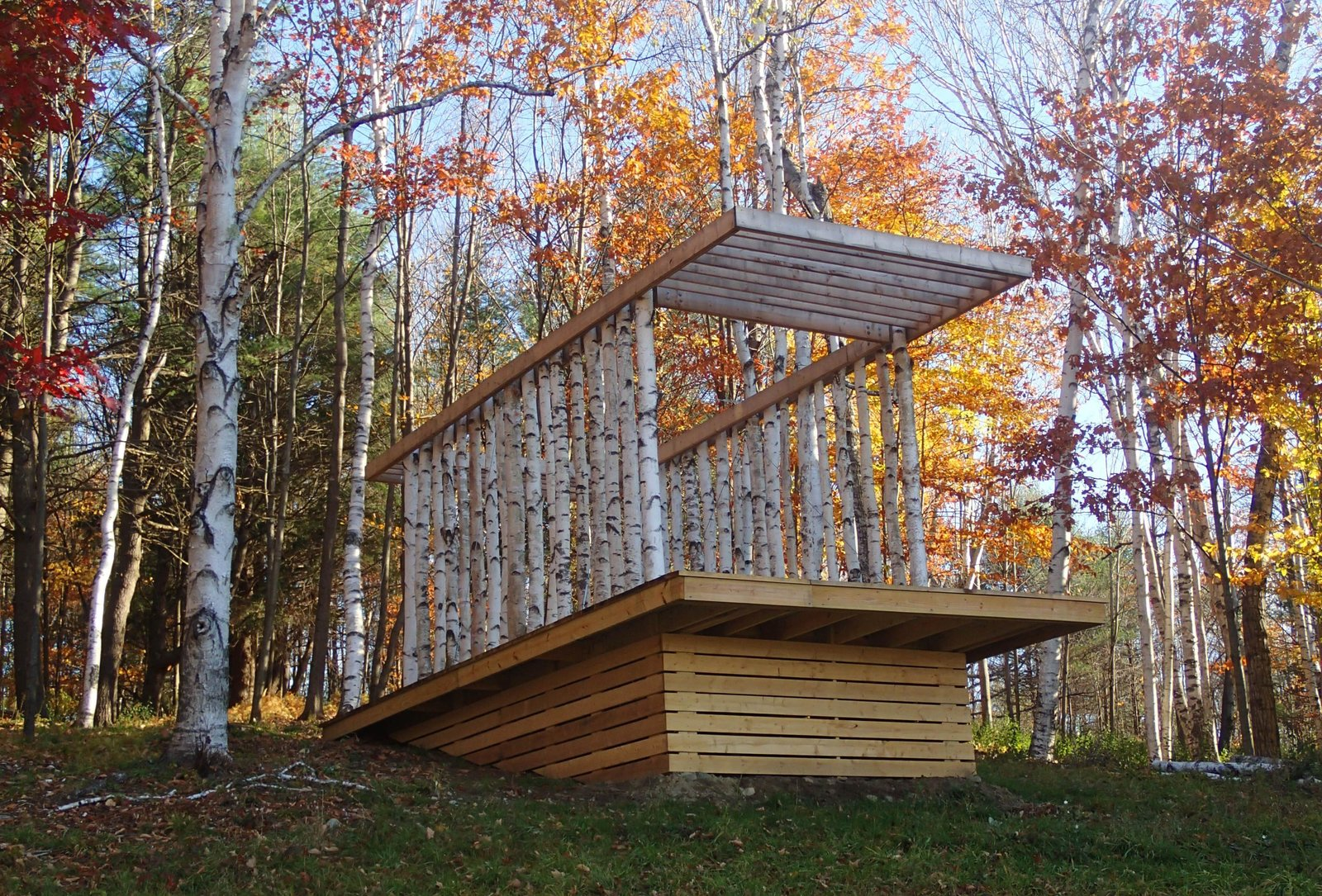 The Birch Pavilion sits atop a 14-by-26-foot platform composed of hemlock and pressure-treated timbers. Photo courtesy of Moskow Linn Architects. Tagged: Exterior and Wood Siding Material.  outside by Molly E. Osler, Interior Design from Aspiring Architects Build a Pavilion in the Vermont Forest