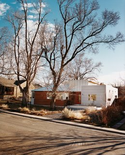 Architect Rob Pyatt's box-shaped addition is the modern kid on the block, with distinctive corrugated-metal and wide-plank cladding. Behind the facade, uncommon materials share a common story with the neighborhood: Of design decisions driven by a desire to keep the next generation—and the planet—healthy and safe.