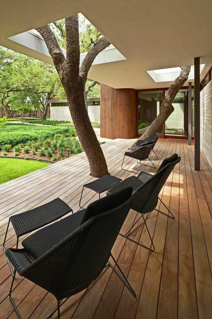 The clients insisted that none of the trees on the property be disturbed, so Kevin Alter and his team at Alterstudio Architecture built a deck and an overhang around two of them. Tagged: Outdoor, Small Patio, Porch, Deck, and Wood Patio, Porch, Deck.  Photo 2 of 7 in A Sensitive Modern House in Austin, Texas