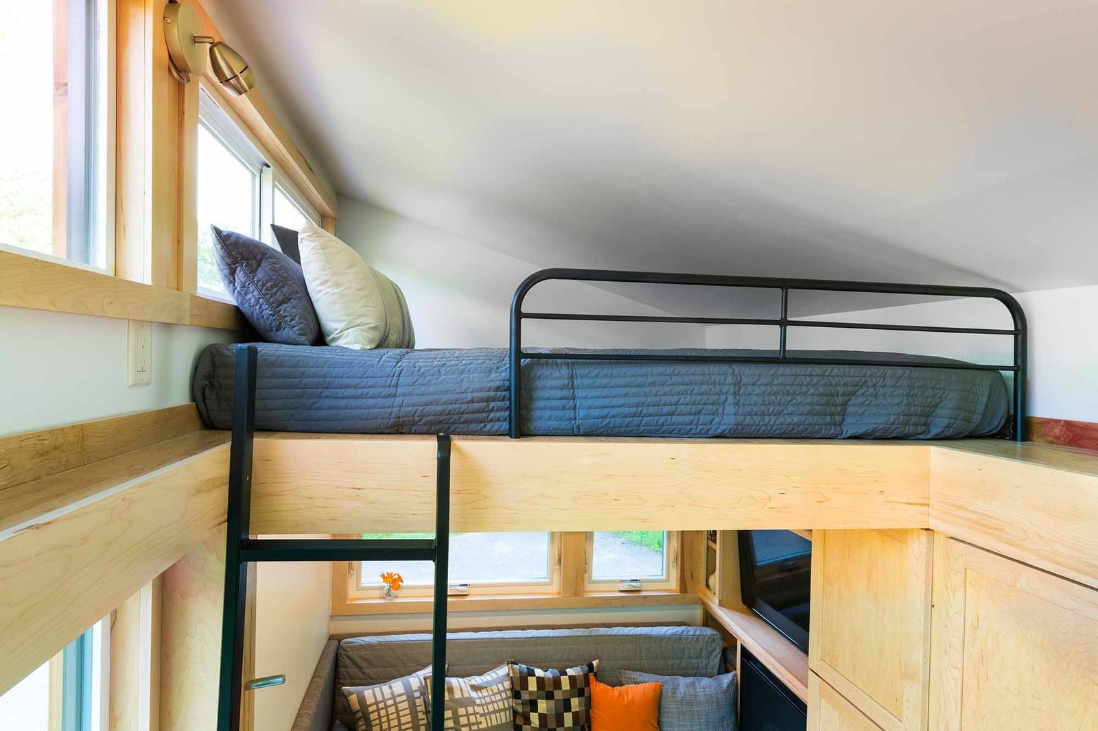 With two sleeping lofts and a convertible daybed, the Traveler can accommodate six.  Loft by Esmeralda from This Travel-Ready Trailer May Look Small, But It Can Sleep Six