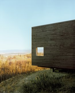 This Modern Cabin Is the Ideal HQ For a Family in Alaska - Photo 3 of 19 - The charred cedar exterior gently basks in the Alaskan sun.