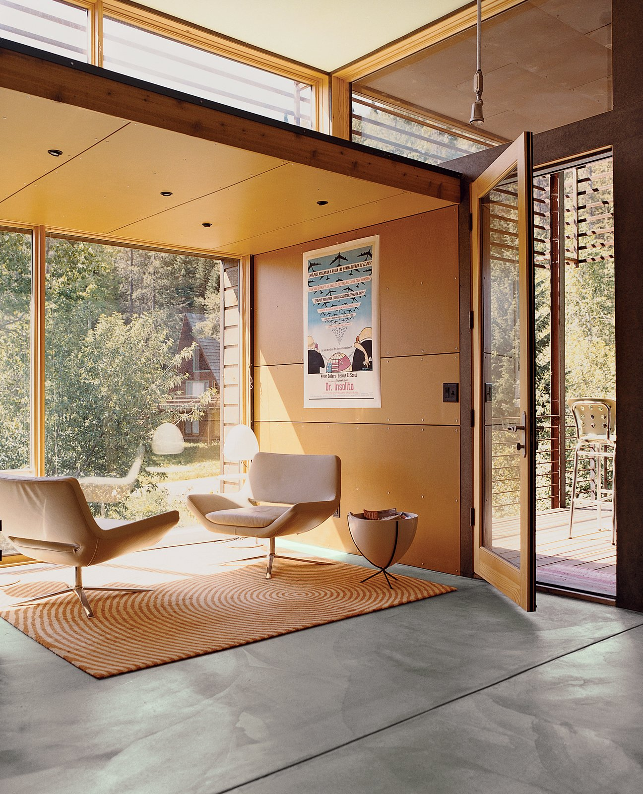 For the interior of the Stanwood residence, Logan returned to his minimalist palette of color and materials. The Stanwoods took particular zeal in furnishing the living area with a number of pieces from Limn in San Francisco, including a pair of B&B Italia chairs and a custom rug from Ligne Roset. Tagged: Living Room, Chair, Concrete Floor, and Rug Floor.  Photo 10 of 10 in Jackson, WY