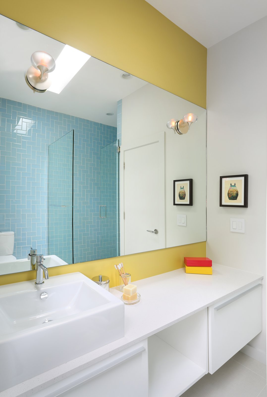 Benjamin Moore's Mustard Field paint adds a vibrant touch to another bathroom in the house.  Lakeview by Diana Budds