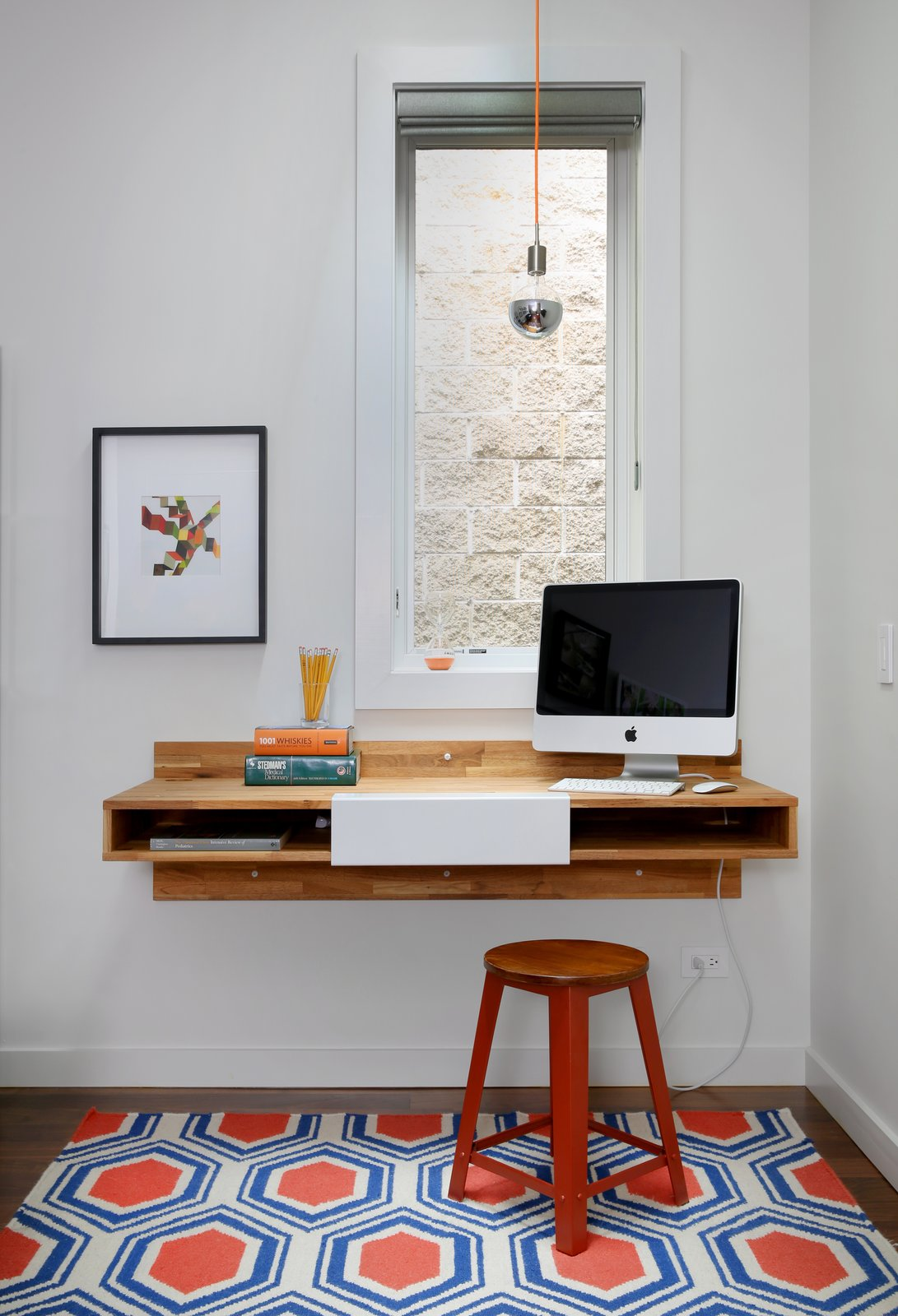 A Mash Studio Wall-Mounted desk offers a place to study. The rug is from One King's Lane and a SoCo Modern Socket pendant illuminates the room. Tagged: Office, Study, and Desk. 10 Essential Tips For Creating a Hardworking Home Office - Photo 2 of 11