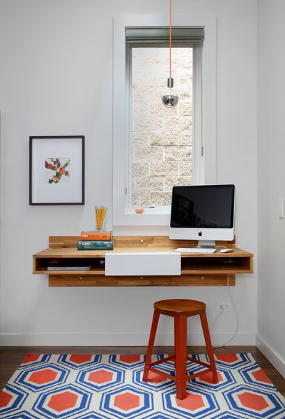 A Mash Studio Wall-Mounted desk offers a place to study. The rug is from One King's Lane and a SoCo Modern Socket pendant illuminates the room. Photo 9 of Lakeview modern home