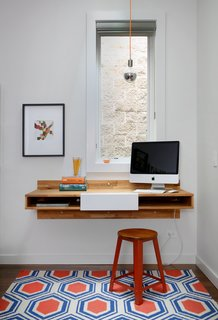 10 Essential Tips For Creating a Hardworking Home Office - Photo 1 of 10 - A Mash Studio Wall-Mounted desk offers a place to study. The rug is from One King's Lane and a SoCo Modern Socket pendant illuminates the room.