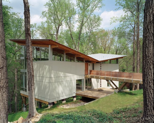 Designed by Frank Harmon this residence features deep roof overhangs shade the interior from high summer sun.
