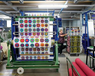 Designers Maija Louekari's Lappuliisa fabric is cut and rolled into bolts. Follow us as we step inside Marimekko's printing factory for a look at how its iconic textiles come to life.