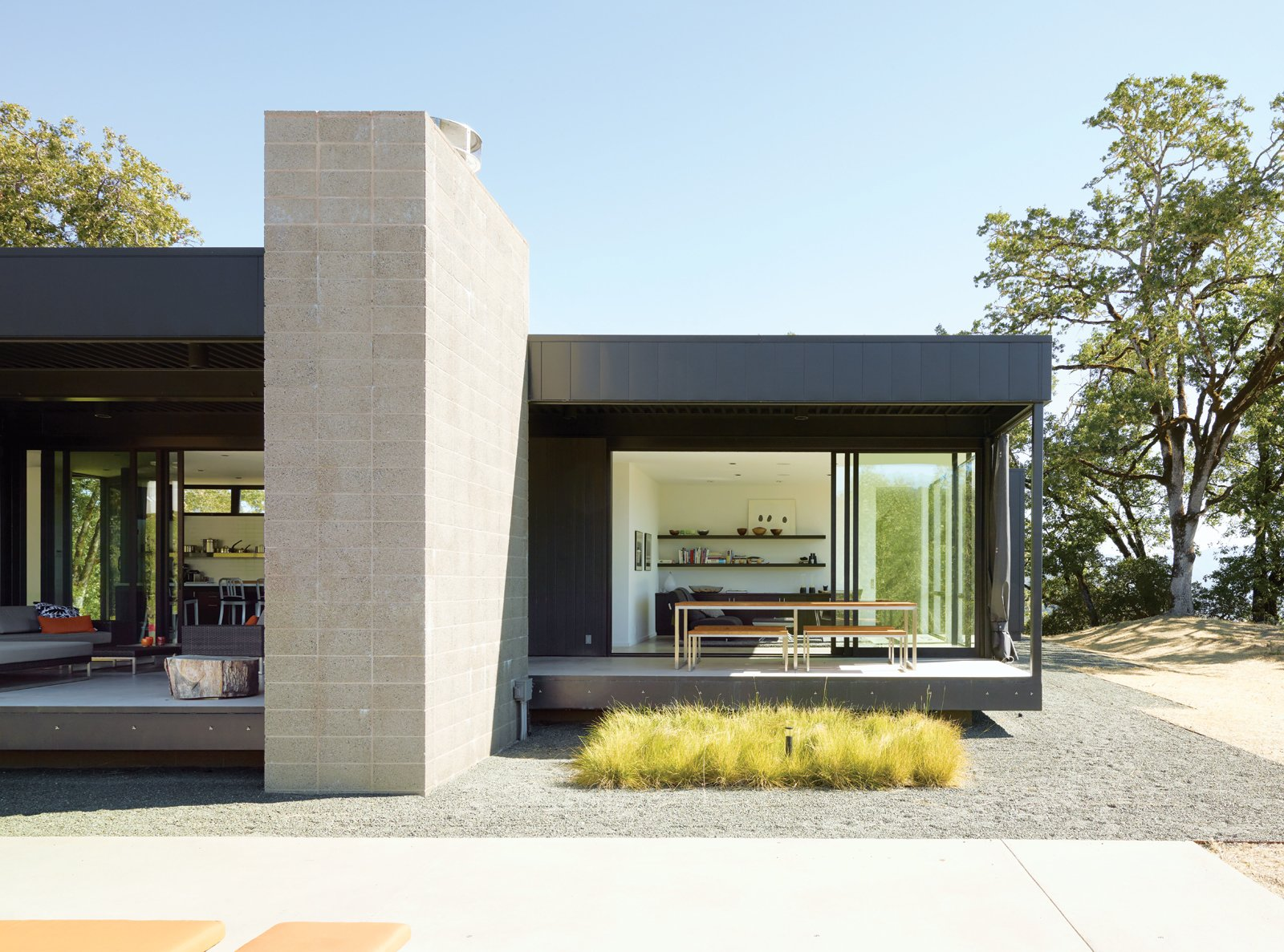 A Simple Plan  A Marmol Radziner–designed prefab house, trucked onto a remote Northern California site, takes the pain out of the construction process. Photo by Dwight Eschliman. Tagged: Outdoor, Shrubs, Back Yard, Small Patio, Porch, Deck, and Concrete Patio, Porch, Deck. Prefab by Arno Sandoval