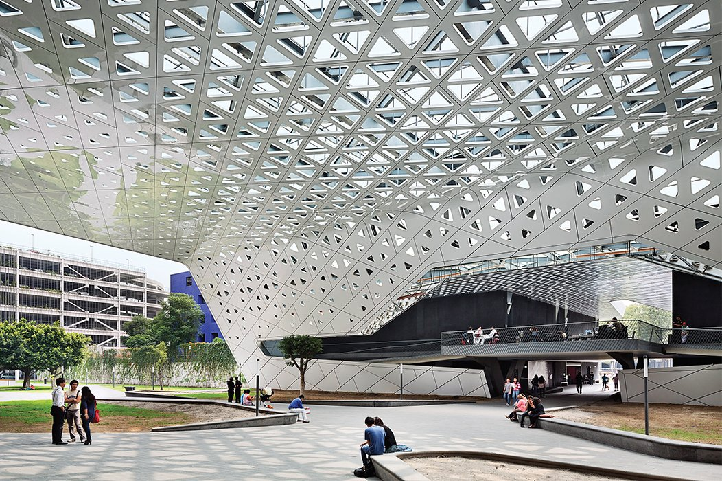 They consolidating surface parking in a new garage and uniting the campus with a canopy whose composite-aluminum skin is dappled with triangular perforations.  Photo 2 of 10 in Rojkind Arquitectos is Transforming Mexico City, One Whimsical Building at a Time